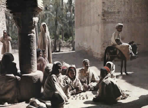 Children play a game outside in the Tozeur oasis.